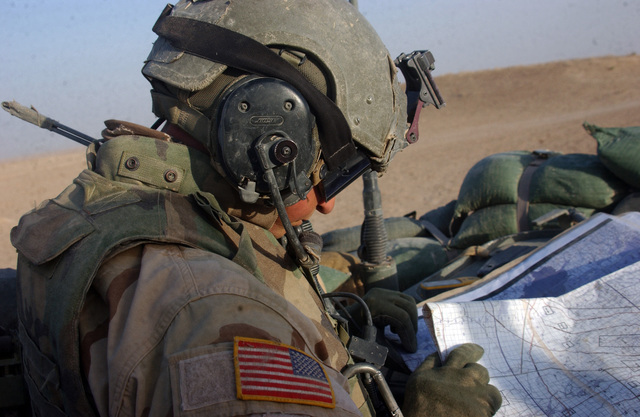 U.S. Army CAPT. James Hayes, commander of C Troop, 2nd Squadron, 14th Cavalry (2-14), checks the route on a map while on patrol near the Syrian border on Aug. 11, 2005.  2-14, operating out of Combat Outpost Rawah, is currently in the area to suppress terrorists from crossing the Syrian border into Iraq.  (U.S. Army photo by STAFF SGT. Kyle Davis)  (Released)