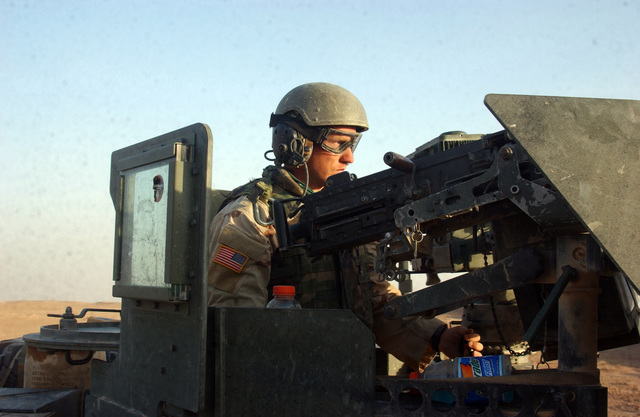 U.S. Army STAFF SGT. Timothy Mangum, with 2nd Squadron, 14th Cavalry (2-14), keeps a sharp lookout from behind the turret mounted .50 cal machine gun during a patrol near the Syrian border on Aug. 11, 2005.  2-14, operating out of Combat Outpost Rawah, is currently in the area to suppress terrorists from crossing the Syrian border into Iraq.  (U.S. Army photo by STAFF SGT. Kyle Davis)  (Released)