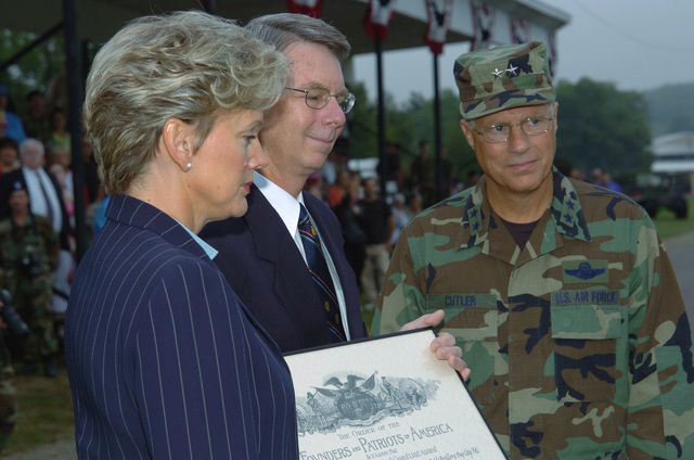 Michigan (MI) Governor Jennifer Granholm and Michigan Army National Guard (MIARNG) Major General (MGEN) Thomas Cutler, present an award from the Founders and Patriots of America during a ceremony at the Annual Training Parade marking the end of the 2005 Annual Training Exercise (ATE) at Camp Grayling, Michigan. (A3596)