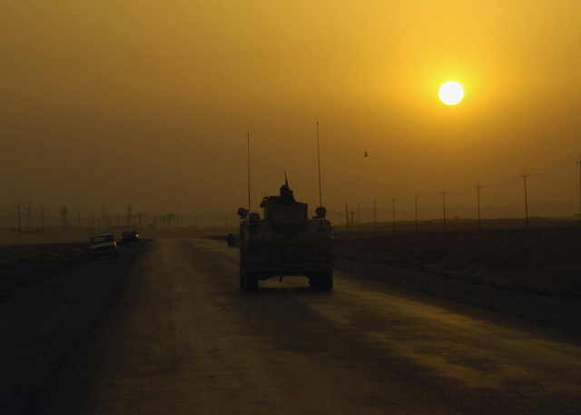 A US Army (USA) M1114 High-Mobility Multipurpose Wheeled Vehicle (HMMWV), 3rd Armored Cavalry Regiment (ACR), 2nd Squadron (Saber), Lion Battery, Fort Carson, Colorado (CO), leads a convoy in the Ninewa province of Iraq, during Operation IRAQI FREEDOM. The 3rd ACR is currently deployed on Forward Operating Base (FOB) Sykes, Iraq