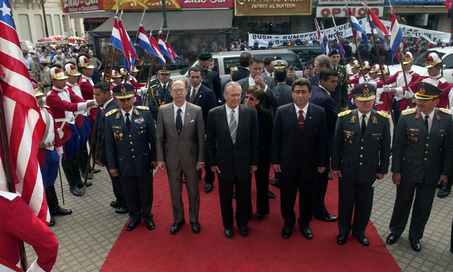 The Honorable Donald H. Rumsfeld, Secretary of Defense, enters the Pantheon of Heroes building with the Paraguay (PRY) Minister of Defense, Roberto Gonzalez and other officials on Aug. 17, 2005.  The Pantheon is the site of the Tomb of Unknown Soldier.  Secretary Rumsfeld is touring parts of Latin America to discuss bilateral military cooperation in the region.  (DoD photo by TECH. SGT. Kevin J. Gruenwald) (Released)