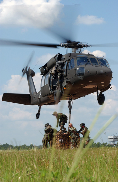 US Army (USA) personnel of the 82nd and 101st Medical Companies, Fort Riley, Kansas (KS), hookup a pallet of supplies to USA MH-60 Black Hawk (Blackhawk) helicopter during an exercise at the Joint Readiness Training Center (JRTC), Fort Polk, Louisiana (LA). This quarterly exercise tests the abilities of the forward-deployed medical community to meet the immediate needs of the wounded warrior