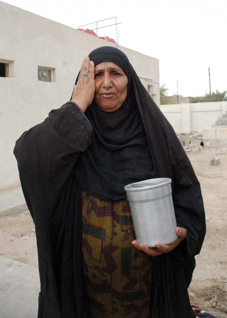 Candid portrait of an Iraqi woman, dressed in Abayah, in Fallujah, Iraq, during Operation IRAQI FREEDOM