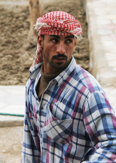 Candid shot of an Iraqi sub-contractor for the US Army Corps of Engineers (USACE) involved in the rehabilitation of a primary school in Najaf, Iraq, during Operation IRAQI FREEDOM. USACE funds and quality controls apply to this rehab and new school construction projects throughout Iraq during Operation IRAQI FREEDOM