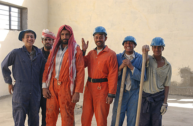 Impromptu group shot of Iraqi sub-contractors involved in the rehabilitation of a primary school in Fallujah, Iraq. US Army Corps of Engineers (USACE) funds and quality controls apply to this rehab and new school construction projects throughout Iraq during Operation IRAQI FREEDOM