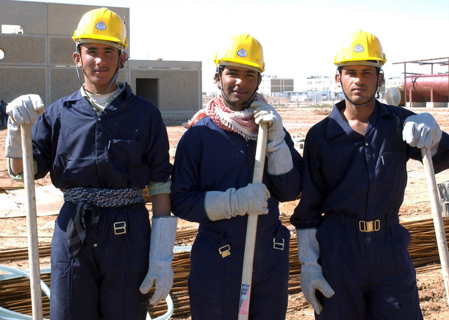 Shot of Iraqi sub-contractors involved in the rehabilitation of a primary school in Fallujah, Iraq. US Army Corps of Engineers (USACE) funds and quality controls apply to this rehab and new school construction projects throughout Iraq during Operation IRAQI FREEDOM