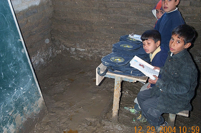 These Iraqi school children attend class inside a building located in Northern Iraq. The building has mud floors and has no heating system, photographed during Operation IRAQI FREEDOM