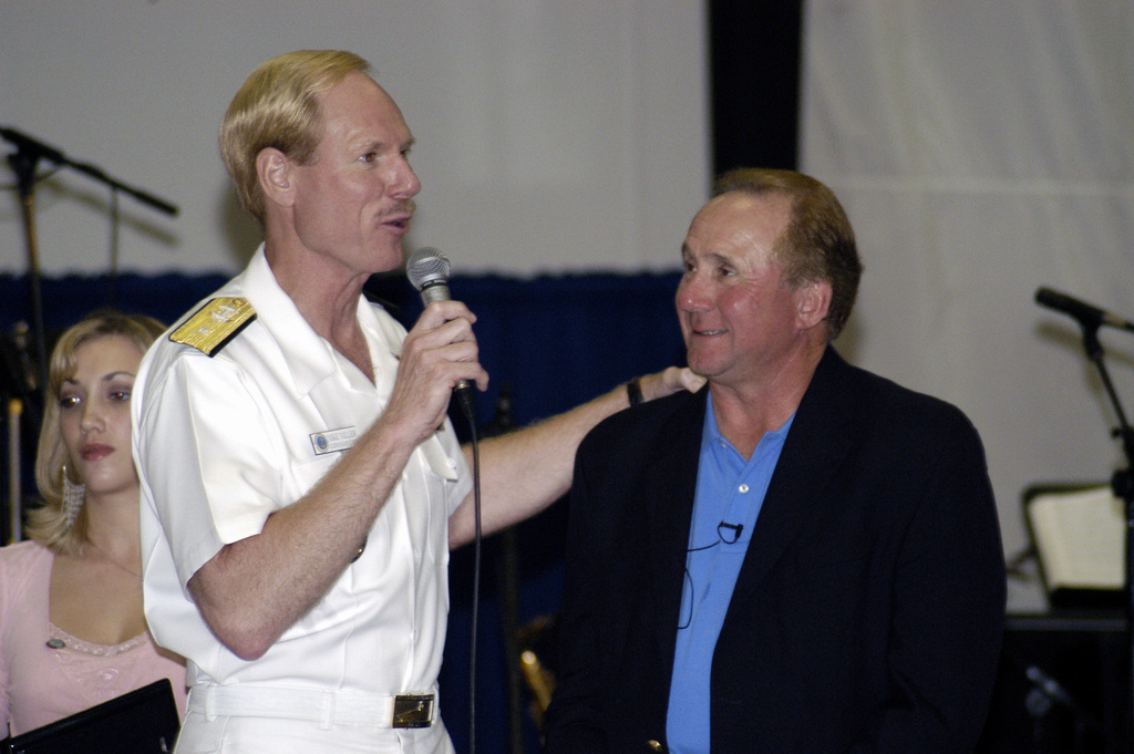 """US Navy (USN) Rear Admiral (RADM) (upper half) Michael H. Miller (left), Commander, Carrier Strike Group 7 (CCG-7), thanks Michael Reagan, son of former US President Ronald W. Reagan and radio talk show host, at the """"Taste of Freedom"""" dinner hosted by the Navy League aboard the Nimitz Class Aircraft Carrier USS RONALD REAGAN (CVN 76). The Navy League is a non-profit organization that provides moral support, recognition and family support for personnel in the US Navy, US Marine Corps, US Coast Guard and the US Flag Merchant Marine for over 100 years"""