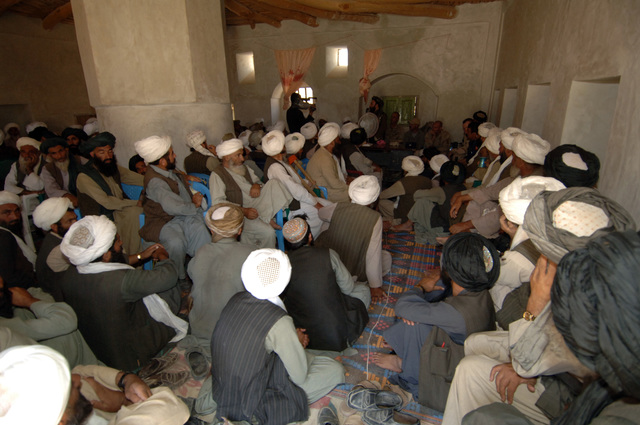 A view of a shura meeting of locals and American Officers held on August 22, 2005 at Baghran Valley, Afghanistan. Shura meetings are going on everywhere in Afghanistan to encourage people to vote on the incoming parliamentary elections on September 18, 2005. (U.S. Army PHOTO by PFC. Leslie Angulo) (Released)