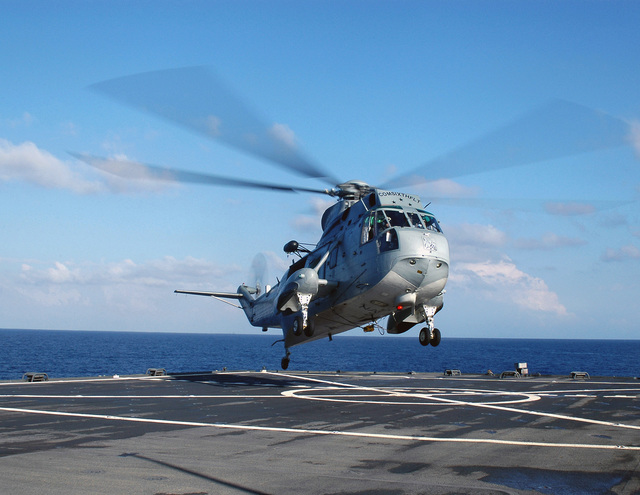A US Navy (USN) UH-3H Sea King helicopter, COMSIXTHFLT (Commander, Sixth Fleet), lands on the flight deck of the Blue Ridge Class Amphibious Command Ship USS MOUNT WHITNEY (LCC 20). The MOUNT WHITNEY is currently underway in the Mediterranean Sea in support of the Joint Forces Maritime Component Commander Europe (JFMCC EUR) STAFF