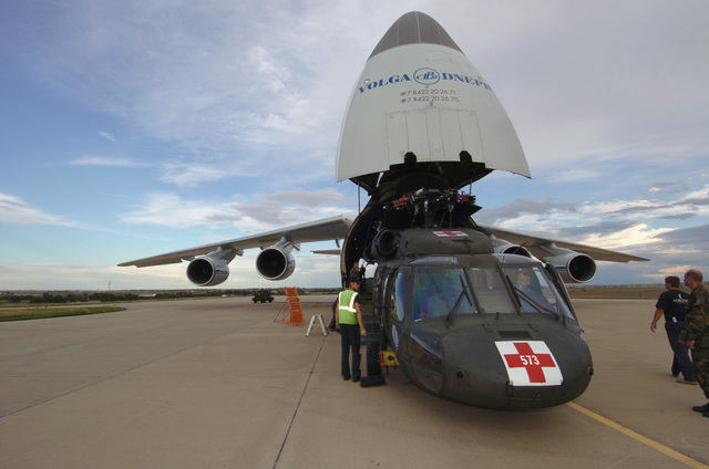 Soldiers from the 1022nd Medical Company (AA), Wyoming Army National Guard (WYARNG), guide an Egypt (EGY) bound UH-60 Black Hawk (Blackhawk) helicopter into an Antanov AN-124 cargo aircraft at Buckley Air Force Base (AFB), Denver, Colorado (CO), in support of Exercise BRIGHT STAR. (A3613)