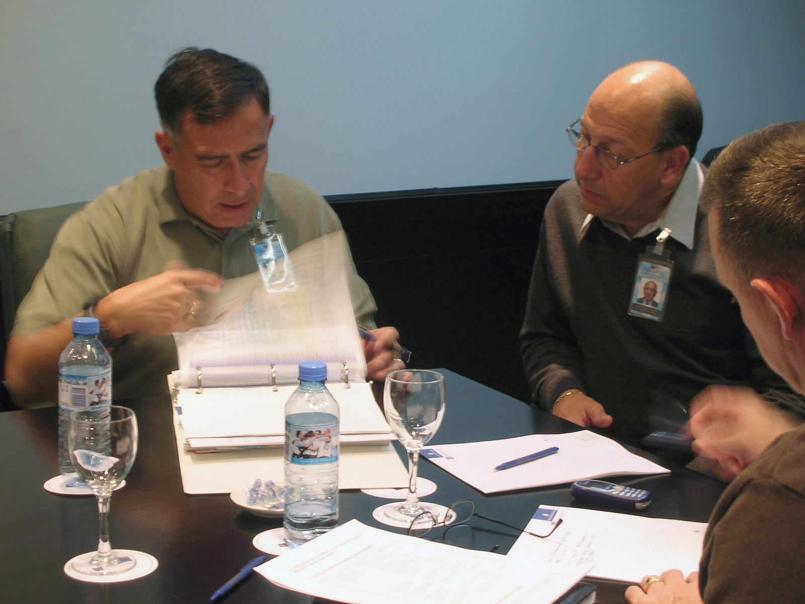 Network Enterprise Technology Command (NETCOM) Operations Commander, US Army (USA) Colonel (COL) David Lopez (left), goes over some notes with Enrique Labrador, USA G-5, during the Preparatory Conference of the Conference of American Armies in Buenos Aires, Argentina (ARG)