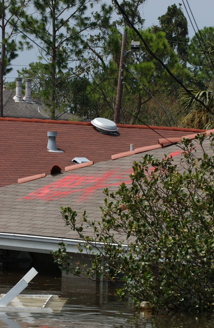 [Hurricane Katrina] New Orleans, LA, August 30, 2005 -- A house in a neighborhood that is flooded as a result of Hurricane Katrina has markings on the roof from FEMA Urban Search and Rescue teams that have been searching for residents unable to reach dry ground.  Jocelyn Augustino/FEMA