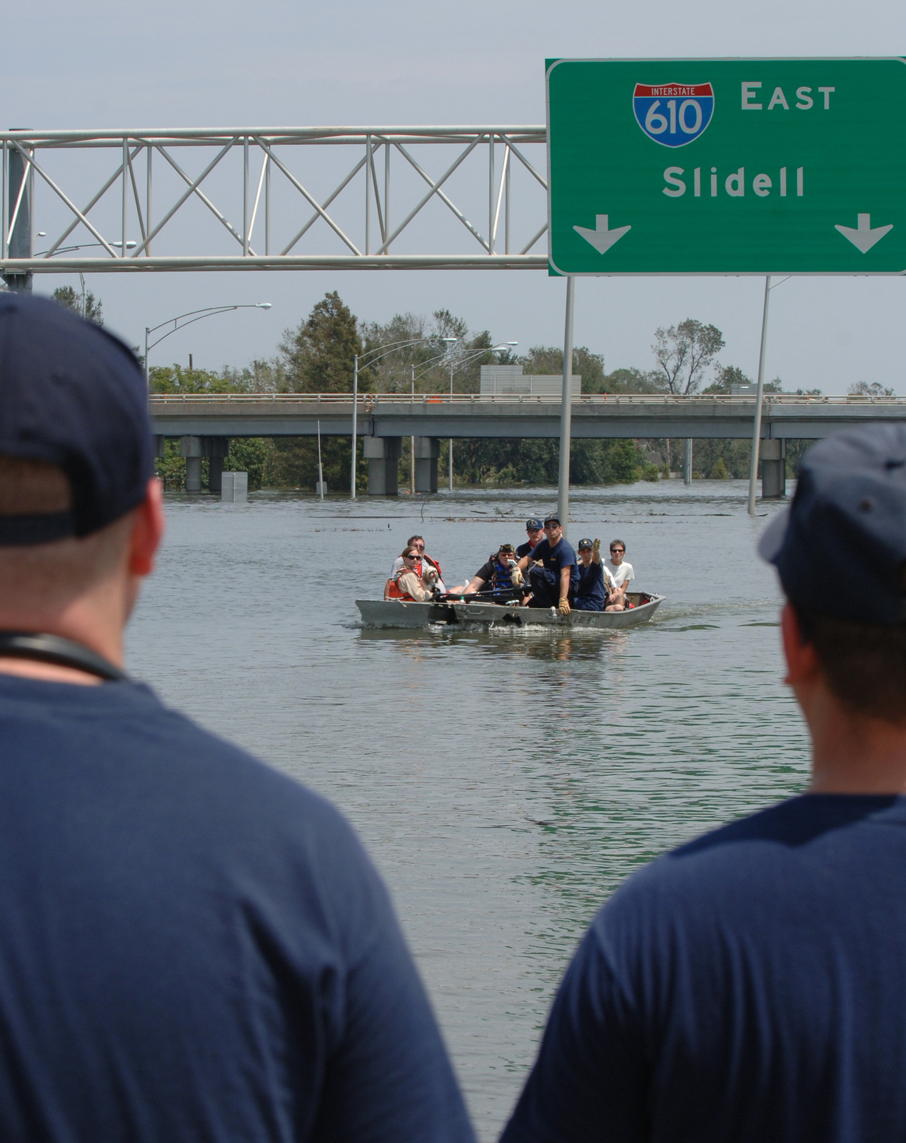 [Hurricane Katrina] New Orleans, LA, August 30, 2005 -- An Urban Search and Rescue Team bring victims of the flood waters of New Orleans to dry land by boat.  New Orleans was evacuated following the breaks in the levees as a result of hurricane Katrina.  Jocelyn Augustino/FEMA