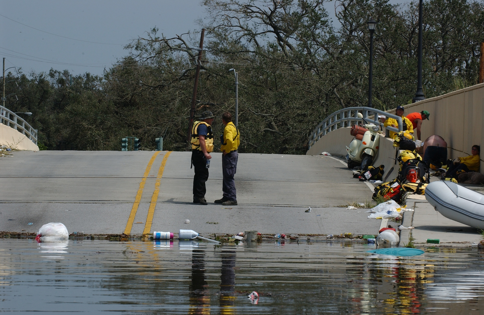 [Hurricane Katrina] New Orleans, LA, August 30, 2005 -- FEMA Urban Search and Rescue workers plan operatons on a bridge that is one of the areas not flooded in a neighborhood where search and rescue operations continue as a result of Hurricane Katrina.  Jocelyn Augustino/FEMA