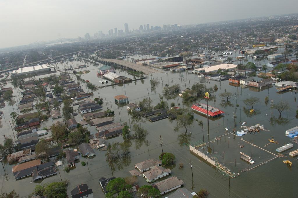 [Hurricane Katrina] New Orleans, LA, August 30, 2005 -- Neighborhoods remain flooded as a result of Hurricane Katrina.  The city of New Orleans is seen in the distance.  Jocelyn Augustino/FEMA