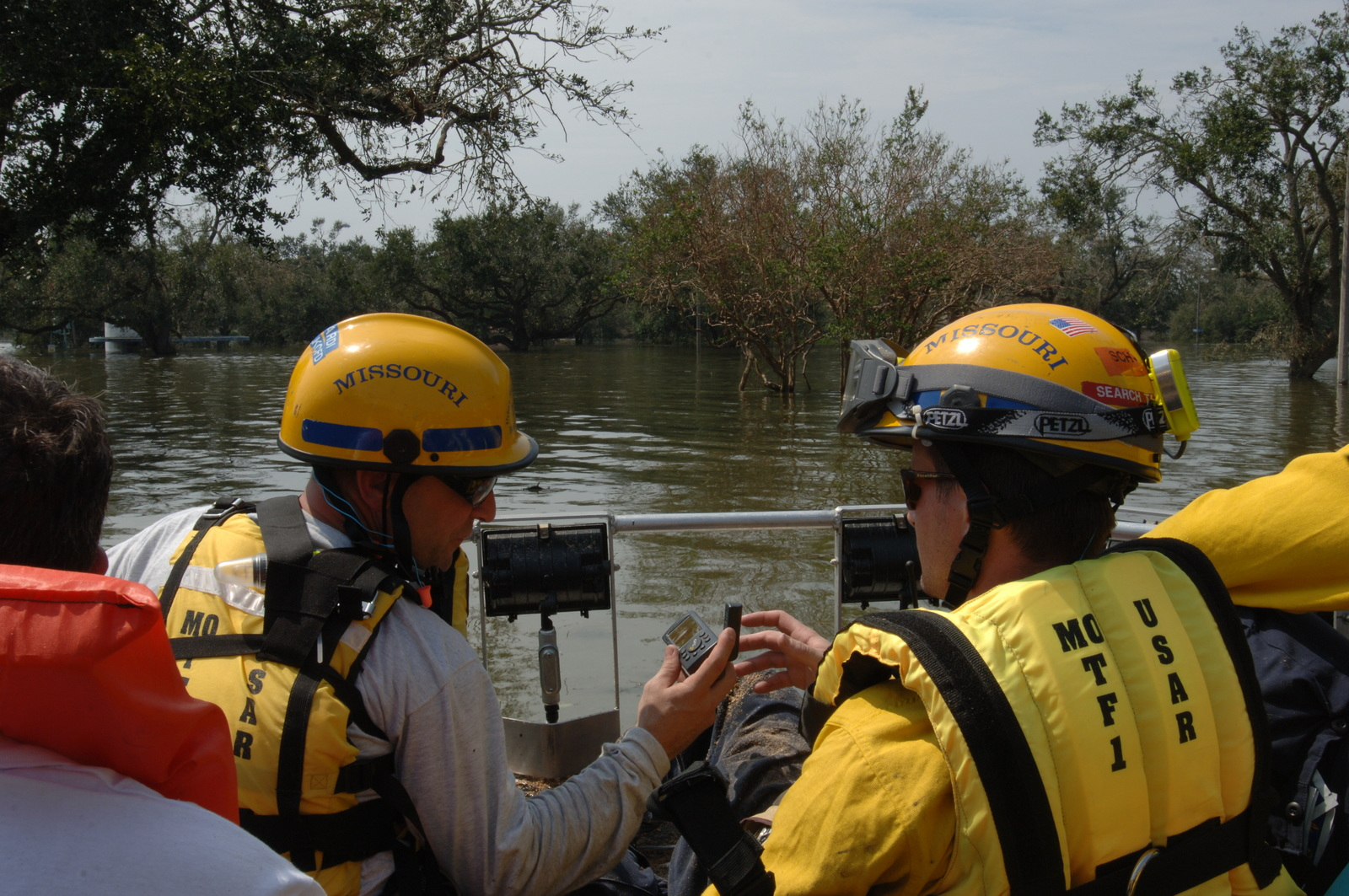 [Hurricane Katrina] New Orleans, LA, August 30, 2005 -- This Urban Search and Rescue (US&R) team from Missouri Task Force 1 uses a GPS in their search of a flooded New Orleans neighborhood.  New Orleans is being evacuated as a result of Hurricane Katrina and teams are searching for victims.  Jocelyn Augustino/FEMA