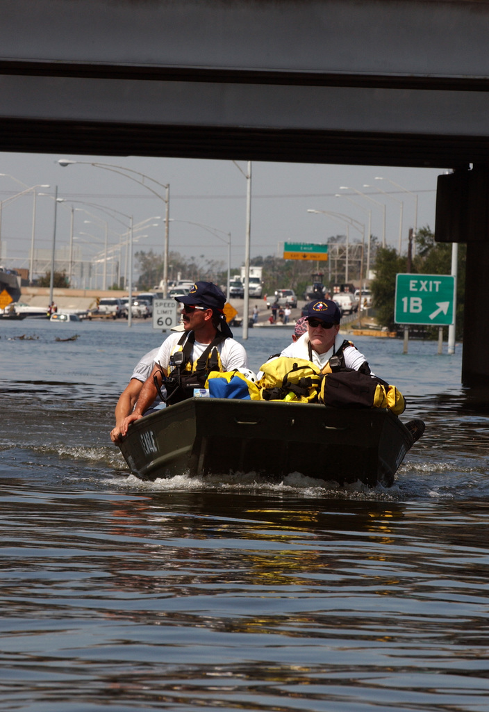 [Hurricane Katrina] New Orleans, LA, August 31, 2005 -- Members of the FEMA Urban Search and Rescue task forces and local rescue personnel continue to travel through New Orleans flood waters to help residents impacted by Hurricane Katrina.  Photo by Jocelyn Augustino/FEMA