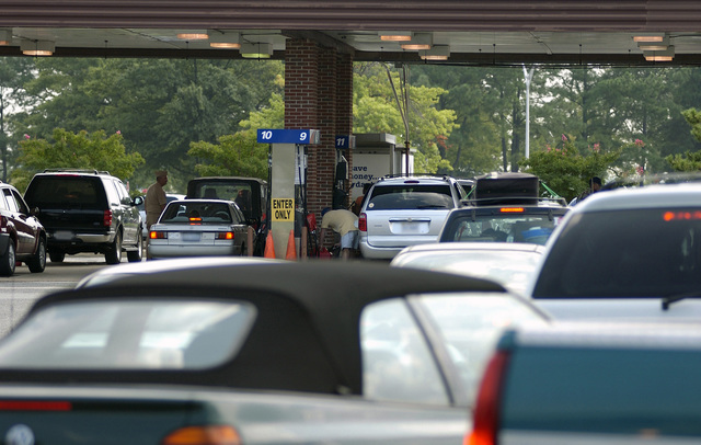 Military personnel flock to the gas pumps at Langley Air Force Base (AFB), Virginia (VA), in anticipation of higher gas prices in the wake of Hurricane Katrina. Gas prices are expected to take a major jump just prior to the Labor Day weekend, after Katrina destroyed many Gulf Coast towns and interrupted oil refineries gas production