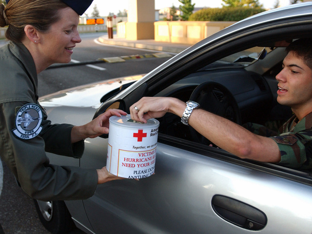 US Air Force (USAF) Technical Sergeant (TSGT) Gina Francis, assigned to the 555th Fighter Squadron (FS), collects donations for Hurricane Katrina victims from a motorists at Aviano, Air Base (AB), Italy