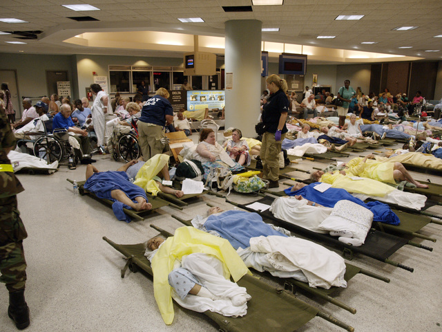 [Hurricane Katrina] New Orleans, La., September 2, 2005 -- Evacuees and patients arrive at New Orleans airport where FEMA's D-MATs have set up operations.  Photo: Michael Rieger/FEMA