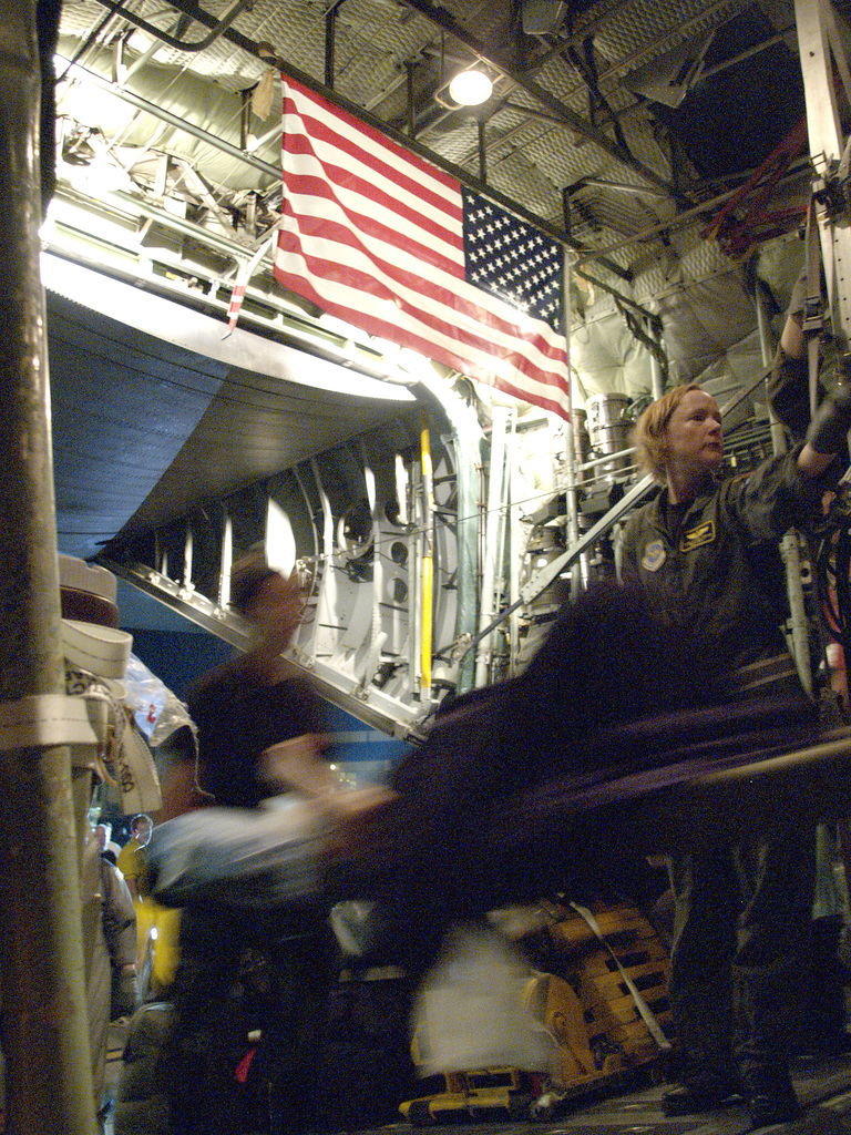 [Hurricane Katrina] New Orleans, La., September 2, 2005 -- Patients are loaded on C-130's for evacuation  at New Orleans airport where FEMA's D-MATs have set up operations.  Photo: Michael Rieger/FEMA