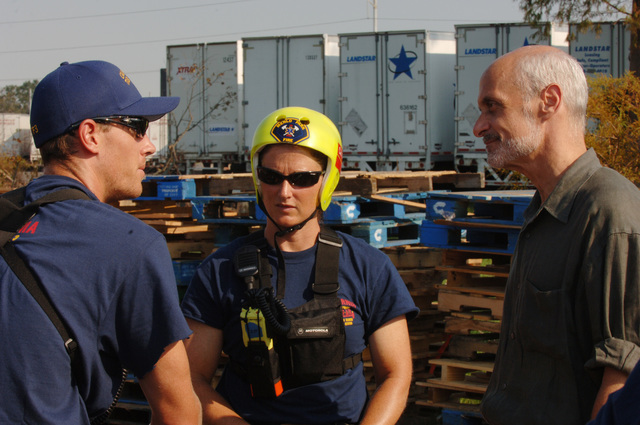 [Hurricane Katrina] New Orleans, LA, September 4, 2005 -- Department of Homeland Security Secretary Michael Chertoff meets with members of the FEMA Urban Search and Rescue task forces at the base of operations set up at the Saint's training facility prior to going out on the day's missions.  Photo by Jocelyn Augustino/FEMA