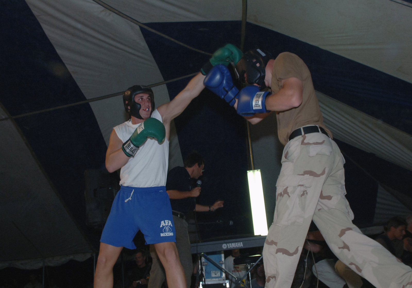 Professional boxer, Super Middleweight Champion, Joey Gilbert, practices his boxing skills with a US Army (USA) Soldier from TaskForce Devil at a show put on by visiting celebrities at Forward Operating Base (FOB) Salerno, in support of Operation ENDURING FREEDOM