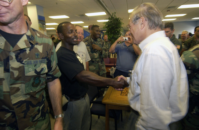 The Honorable Donald H. Rumsfeld (left), U.S. Secretary of Defense, meets U.S. Air Force STAFF SGT. La Shawndra Singleton (right), who single-handedly helped stop a car jacking as a local gas station, during his visit to Keesler Air Force Base, Miss., on Sept. 4, 2005, to meet with U.S. Air Force personnel, assess humanitarian efforts, and to survey the damage to the base caused by Hurricane Katrina. (DoD photo by TECH. SGT. Mike Buytas) (Released)