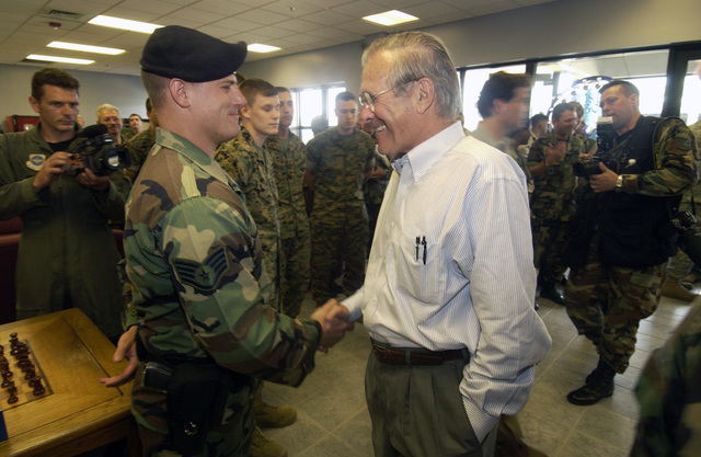The Honorable Donald H. Rumsfeld (right), U.S. Secretary of Defense, meets with a local Civil Engineering contractor (second from left) during his visit to Keesler Air Force Base, Miss., on Sept. 4, 2005, to meet with U.S. Air Force personnel, assess humanitarian efforts, and to survey the damage to the base caused by Hurricane Katrina. (DoD photo by TECH. SGT. Mike Buytas) (Released)