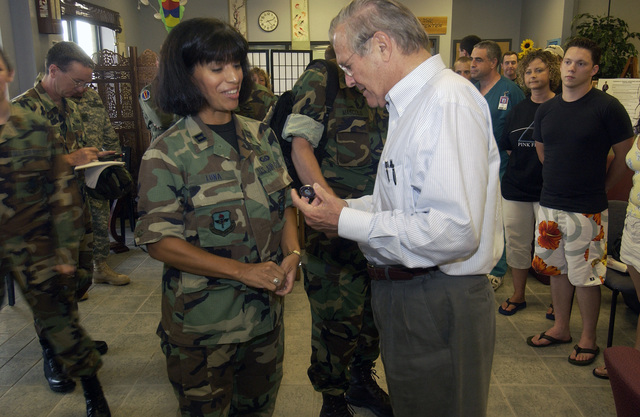 The Honorable Donald H. Rumsfeld (right), U.S. Secretary of Defense, meets with a U.S. Air Force Security Forces member (left) during his visit to Keesler Air Force Base, Miss., on Sept. 4, 2005, to meet with U.S. Air Force personnel, assess humanitarian efforts, and to survey the damage to the base caused by Hurricane Katrina. (DoD photo by TECH. SGT. Mike Buytas) (Released)