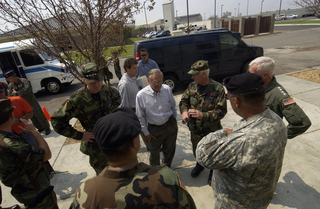 The Honorable Donald H. Rumsfeld (second from left), U.S. Secretary of Defense, and U.S. Air Force GEN. Richard B. Myers (left), Chairman of the Joints Chiefs of STAFF, speak to displaced military family members, who have lost everything and are evacuating the area, during their visit to Keesler Air Force Base, Miss., on Sept. 4, 2005, to meet with U.S. Air Force personnel, assess humanitarian efforts, and to survey the damage to the base caused by Hurricane Katrina. (DoD photo by TECH. SGT. Mike Buytas) (Released)