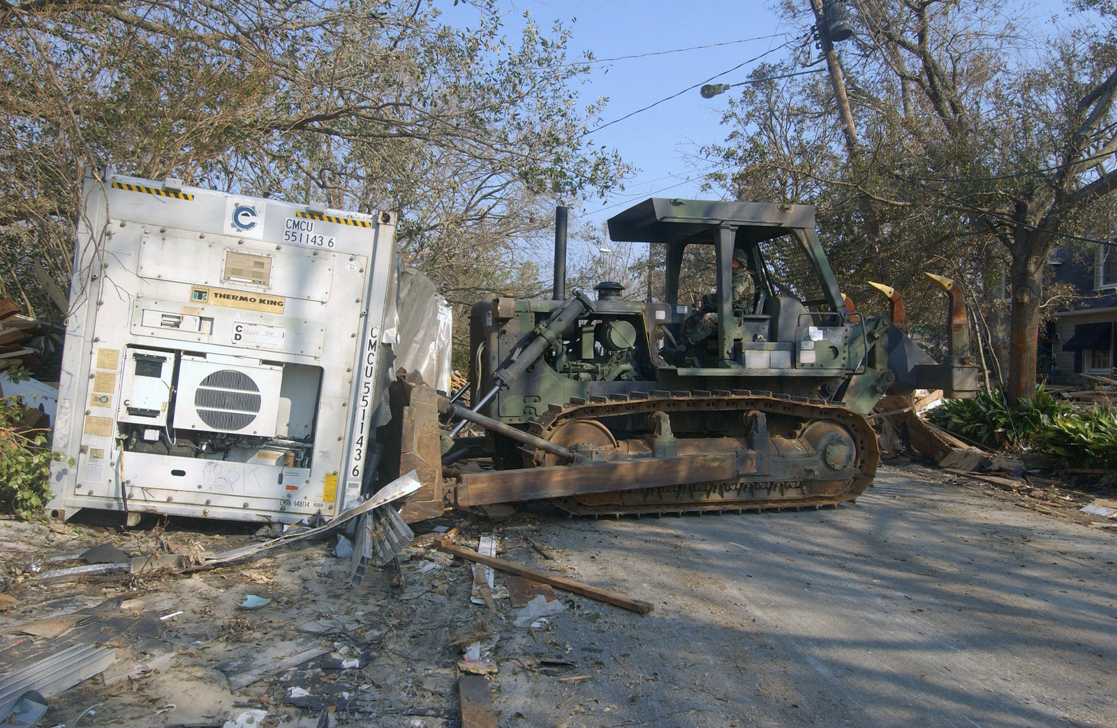 US Army (USA) Sergeant (SGT) Ronnie Thomas, assigned to the 230th Engineering Battalion, Tennessee (TN) Army National Guard, clears a road with a bulldozer in Biloxi, Mississippi (MS), after the Hurricane Katrina battered the Gulf Coast with wind gusts in excess of 140 miles per hour, leaving millions of people without power and hundreds of thousands homeless