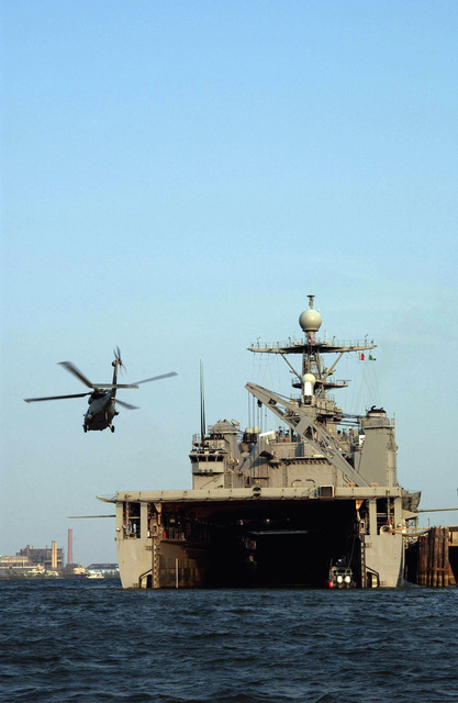 A US Navy (USN) SH-60 Seahawk helicopter filled with evacuees comes in for a landing on to the USS TORTUGA (LSD-46), under way in the Gulf of Mexico. The TORTUGA provides hot meals, showers and beds for the survivors of Hurricane Katrina