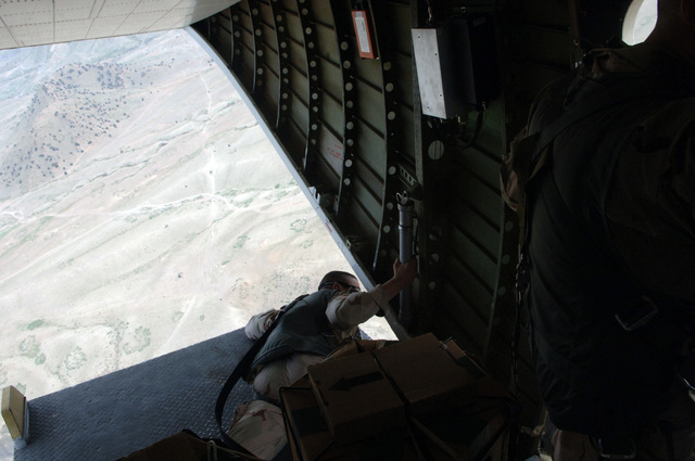 LT. COL. Neil Higgins of Combined/Joint Task Force 76 (CJTF76) looks off the edge of the ramp over Forward Operating Base (FOB) Salerno, Afghanistan on Sept. 8, 2005.  CJTF76 conducted a leaflet drop near FOB Salerno.(U.S. Army photo by SPC. Joshua Balog) (Released)