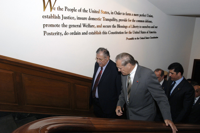 The Honorable Donald H. Rumsfeld (right), U.S. Secretary of Defense, and Jalal Talibani, President of Iraq, pass by the Preamble to the United States Constitution on their way to a meeting in the Pentagon, Washington, D.C., Sept. 9, 2005.  (DoD photo by Helene C. Stikkel) (Released)