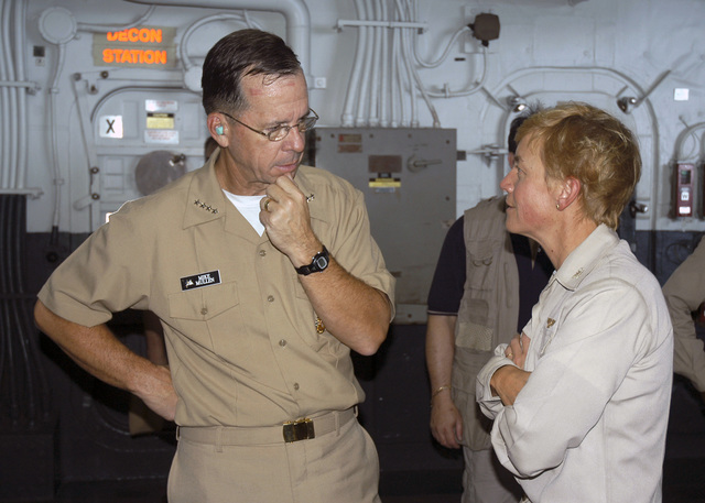 US Navy USN) Admiral ADM) Michael G. Mullen left), CHIEF of Naval Operations CNO), speaks with the Commanding Officer of the Amphibious Assault Ship, USS BATAAN LHD 5), USN Captain CPT) Nora Tyson, following an All Hands Call held aboard ship while participating in humanitarian missions for victims of Hurricane Katrina. The CHIEF of Naval Operations CNO) and MASTER CHIEF PETTY Officer of the Navy MCPON) are traveling the gulf coast to get a personal assessment of damages caused by the hurricane. The USN is currently involved in Hurricane Katrina humanitarian assistance operations, led by the Federal Emergency Management Agency FEMA), in conjunction with the Department of Defense...