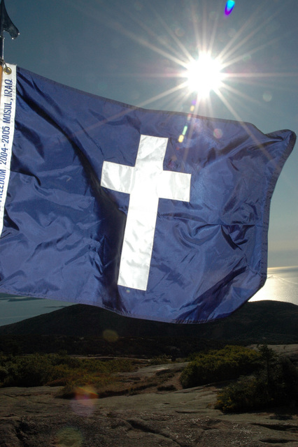The Chaplain's flag flies atop Cadillac Mountain, Acadia National Park, Maine (ME), during a devotional service in remembrance of the terrorist attack of September 11, 2001. (A3581)