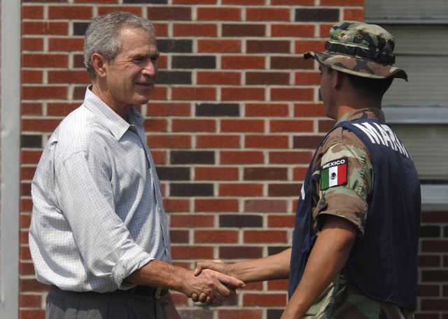 US President George W. Bush conveys his gratitude to a Marine from the Federal Republic of Mexico, during the clean-up efforts underway at the 28th Street Elementary School in Gulfport, Mississippi (MS). President Bush is currently visiting the Gulf Coast region to assess the damage and disaster recovery efforts from Hurricane Katrina. The Mexican Navy is assisting the USN currently involved in Hurricane Katrina humanitarian assistance operations, led by the Federal Emergency Management Agency (FEMA), in conjunction with the Department of Defense (DOD)