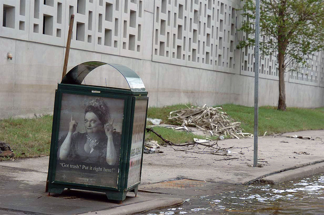Trash and debris surround the trash receptacle sitting near a flooded street corner in the aftermath of Hurricane Katrina, in New Orleans, Louisiana (LA). (A3604)