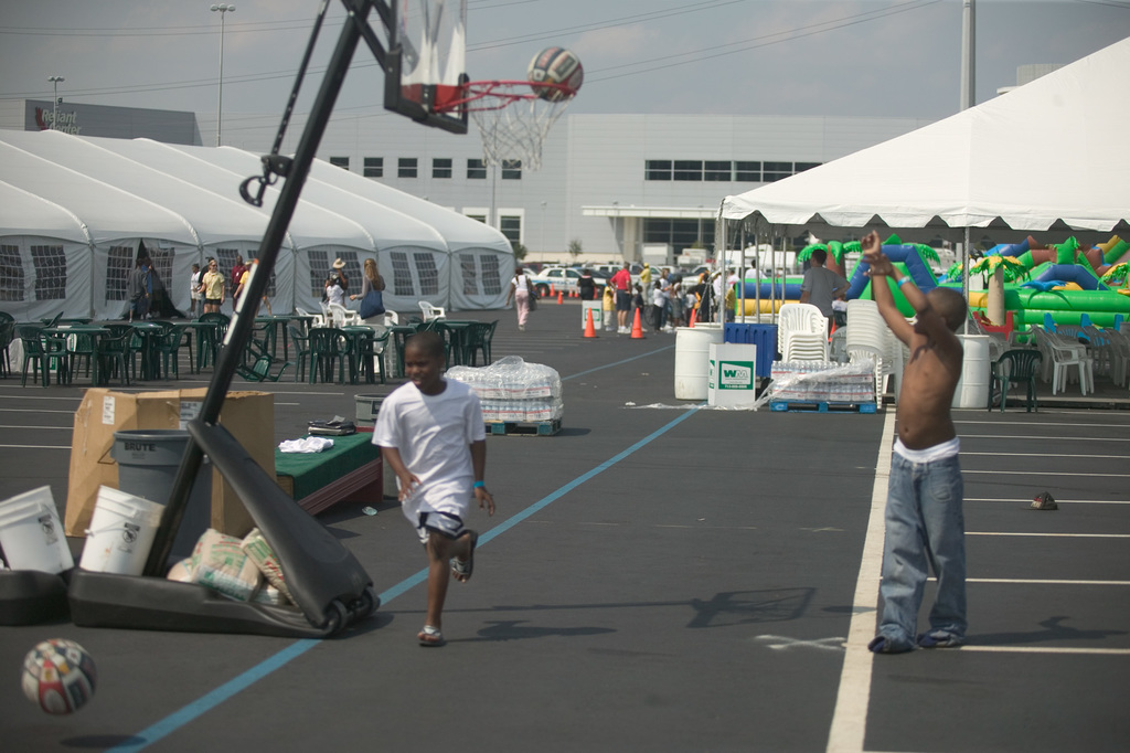[Hurricane Katrina] Houston, TX, 9/12/2005 -- Basketball hoops and playground set up by the YMCA for the children sheltered in the Reliant Center and Astrodome following Hurricane Katrina.  FEMA photo/Andrea Booher