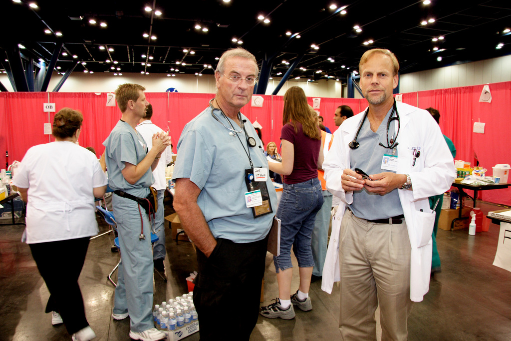[Hurricane Katrina] Houston, TX, September 14, 2005-  Drs. Brent Eastman and Peter Aldrick of the Scripps Medical Group of San Deigo manage a medical facility at the George  R. Brown Center.  Hundreds of displaced New Orleans residents are being sheltered in Houston.  Photo by Ed Edahl/FEMA