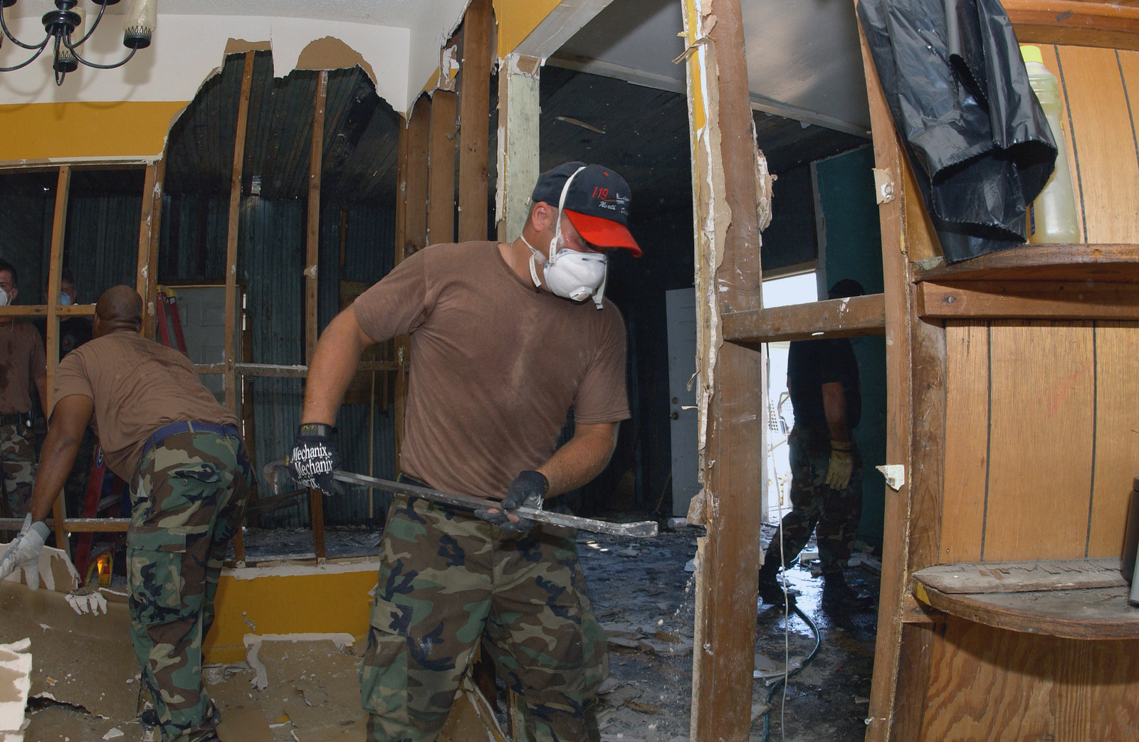 North Dakota Air National Guard (NDANG) SENIOR AIRMAN (SRA) John C. Herman, 119th Fighter Wing (FW), Hector Field (FLD), North Dakota (ND), removes plasterboard from a Hurricane Katrina flood damaged home in D'Iberville, Mississippi (MS). The plasterboard must be removed because of mold that grew on it after it is submerged in the floodwaters from the storm surge