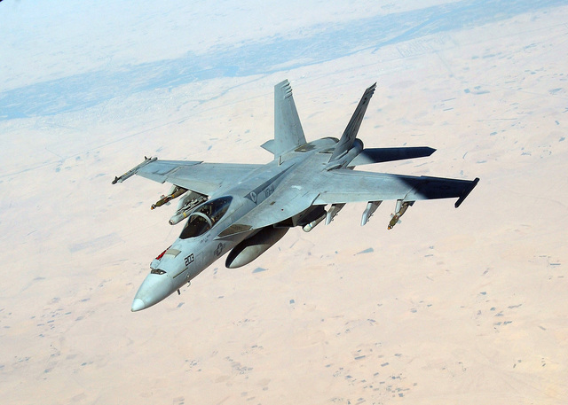 A US Navy (USN) F/A-18E Super Hornet fighter, Strike Fighter Squadron 14 (VFA-14), Tophatters, Naval Air Station (NAS) Lemoore, California (CA), conducts a mission over e Persian Gulf region. The Hornet is armed wi an AIM-9 Sidewinder missile on e wingtip and a couple of GBU-12 500-pound bombs, plus an AGM-65 Maverick missile on e pylon. Tucked under e intake is an AAQ-14 LANTIRN (Low-Altitude Navigation and Targeting InfraRed for Night) pod. Also under e fuselage, a 370-gallon External Fuel Tank. The VFA-14 is currently embarked aboard e USN Aircraft Carrier USS NIMITZ (CVN 68). The Nimitz Carrier Strike Group is currently on a regularly scheduled deployment in support of...