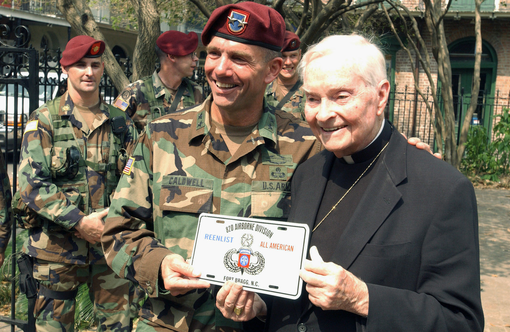 The Archbishop of the state of Louisiana (LA), Phillip Hannan, receives a Reenlist 82nd Airborne Division license plate from US Army (USA) Major General (MGEN) William Caldwell, IV (center), Commander of the 82nd Airborne Division (AD) and Command Sergeant Major (CSM) Wolf Amacker, during a visit to the St. Louis Cathedral, in New Orleans. (SUBSTANDARD)