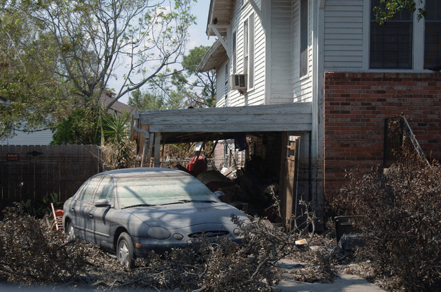 A car sits in the driveway of a home that was flooded by Hurricane Katrina. The marks on the car show that at one point it was completely submerged during the flood