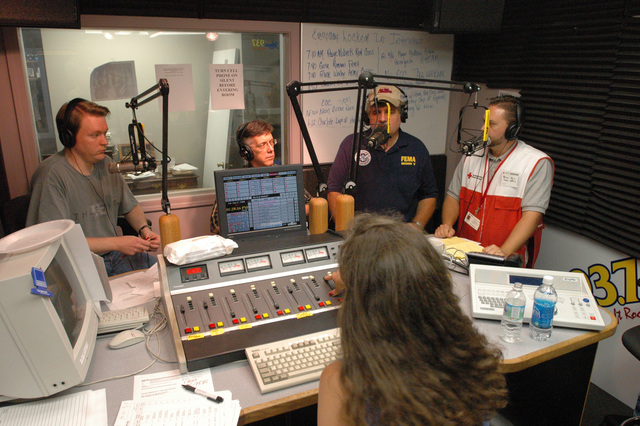 [Hurricane Katrina] Biloxi, Miss., September 17, 2005 -- Representatives from the US Army Corps of Engineers, Red Cross, FEMA and the Small Business Administration answer listener's questions at a local Biloxi, Miss. radio station.  Many agencies are involved in the recovery from Hurricane Katrina.  FEMA/Mark Wolfe