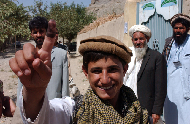 A voter from the village of Moraqhja, proudly displays his finger, showing that he has voted in the first parlamentary elections in Afghanistan, Sept. 18, 2005. (U.S. Army photo by STAFF SGT. Ken Denny) (Released)