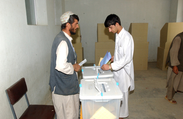 An Afghan citizen places his ballot in the ballot box after voting in the countries first parliamentary elections, Sept 18, 2005. (U.S. Army photo by SPC. Jason R. Krawczyk) (Released)