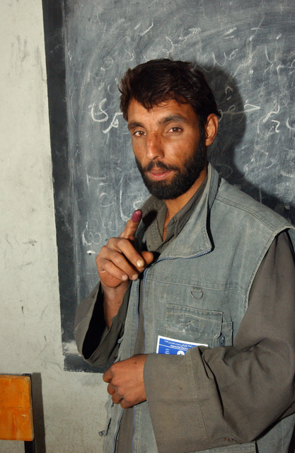 An Afghan citizen shows off his ink marked finger after voting in the countries first parliamentary elections, Sept 18, 2005. (U.S. Army photo by SPC. Jason R. Krawczyk) (Released)